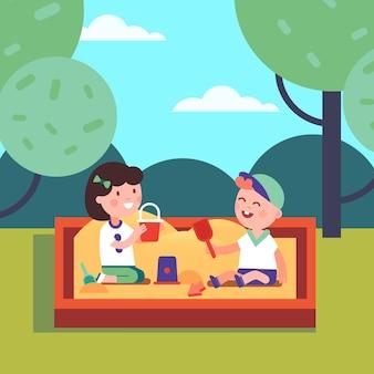 Chłopiec i dziewczynka grają w sandpit