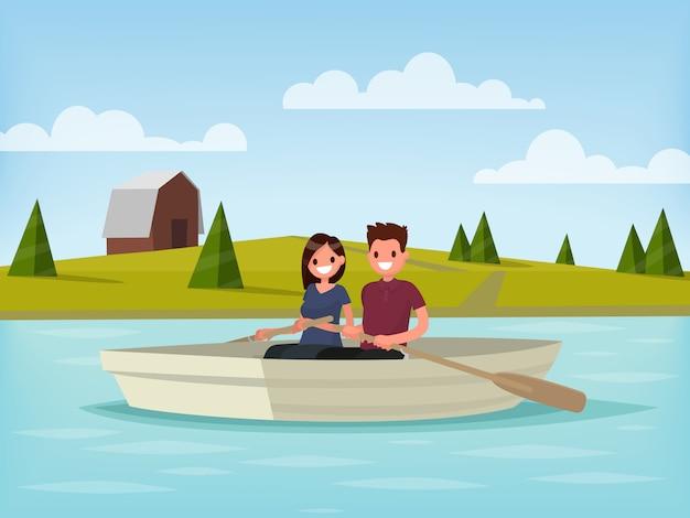 Chłopiec i dziewczynka płyną łodzią. młoda para jest relaks na jeziorze.