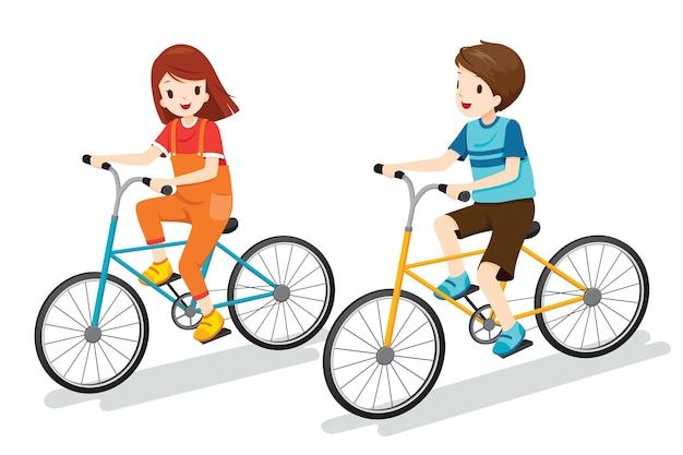 Chłopiec i dziewczynka razem jeżdżą na rowerze, ćwiczenia dla dobrego zdrowia