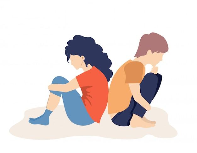 Chłopiec i dziewczynka są smutnymi nastolatkami. przygnębione smutne nastolatki siedzą na podłodze. nastolatki w depresji. kłócąca się dziewczyna i facet siedzą tyłem do siebie.