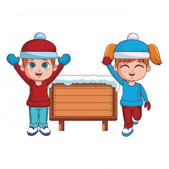 Chłopiec i dziewczynka z zimowe ubrania i drewniany znak