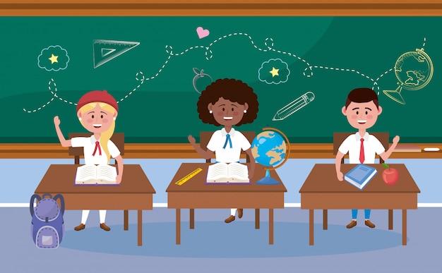 Chłopiec i dziewczyny ucznie w biurku z książką