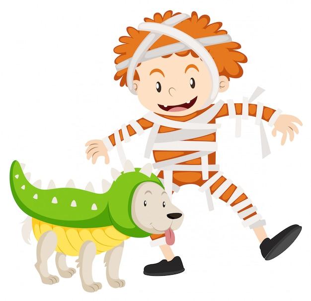 Chłopiec i pies w kostiumy na halloween