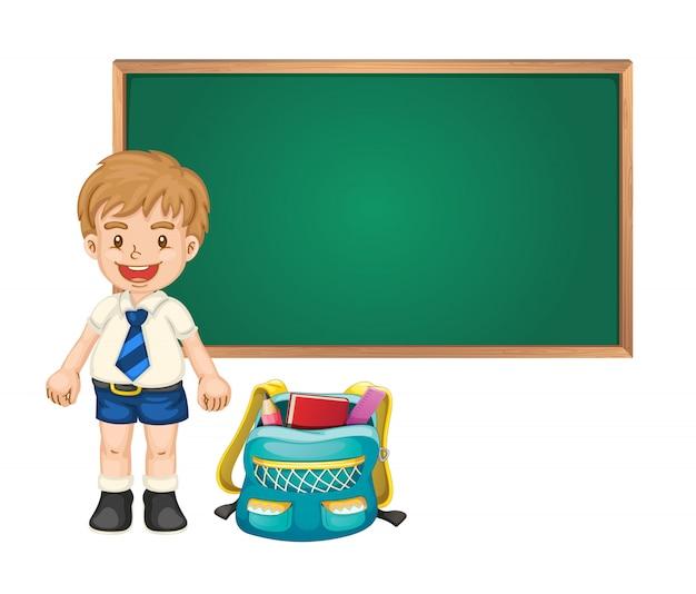 Chłopiec i zielona tablica