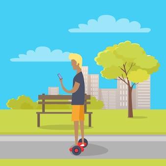 Chłopiec jedzie na dwukołowym mini segway w parku