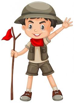 Chłopiec jest ubranym safari strój odizolowywającego