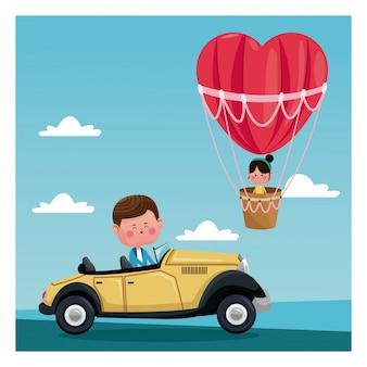 Chłopiec kierowcy klasycznej samochodowej dziewczyny balonu latająca kierowa walentynki