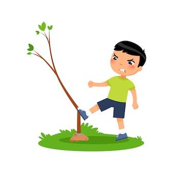 Chłopiec łamanie młode drzewo na białym tle