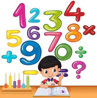 Chłopiec liczy liczby na biurku