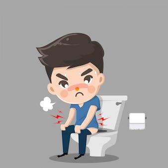Chłopiec ma ból brzucha i musi się ruszać. siedzi, prawidłowo spłukując toaletę.