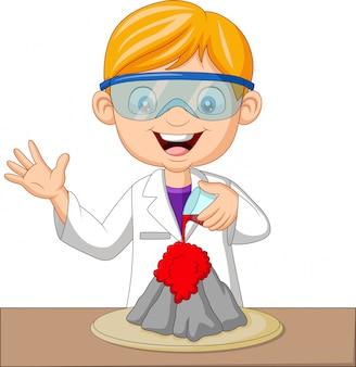 Chłopiec naukowiec kreskówka robi eksperyment wulkanu