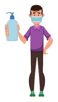 Chłopiec nosi maskę i pokazuje butelkę do dezynfekcji rąk