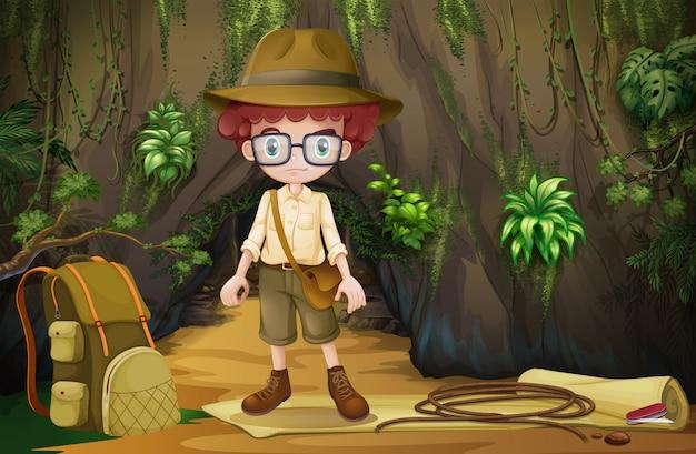 Chłopiec obozuje w jaskini