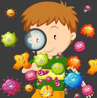Chłopiec patrzeje bakterie przez powiększać - szkło