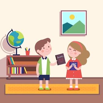 Chłopiec podając książkę o zwierzętach do dziewczyny