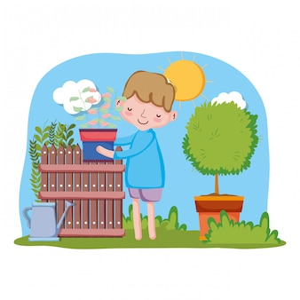 Chłopiec podnośny houseplant z ogrodzeniem i drzewem