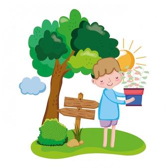 Chłopiec podnośny houseplant z strzała znakiem i drzewem