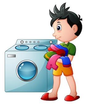 Chłopiec robi pralni z pralką