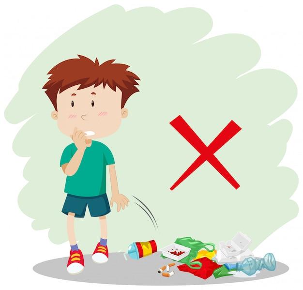 Chłopiec rzuca śmieci na ulicie