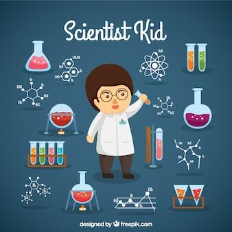 Chłopiec scientist z obiektami laboratoryjnych
