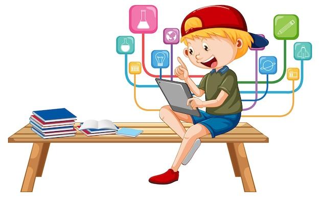 Chłopiec siedzący na ławce uczący się z tabletu