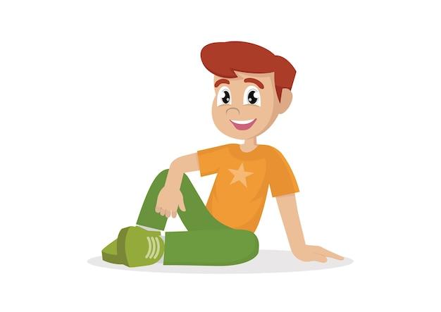 Chłopiec siedzi na podłodze.