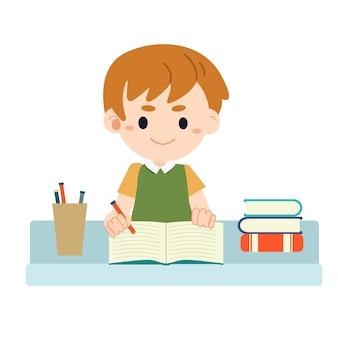 Chłopiec siedzi przy stole i odrabiania lekcji.