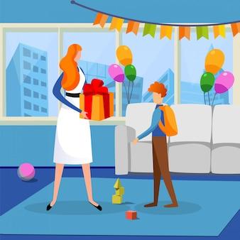 Chłopiec świętuje urodziny i dostaje prezent od matki.