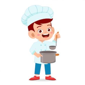 Chłopiec szczęśliwy słodkie dziecko w stroju szefa kuchni