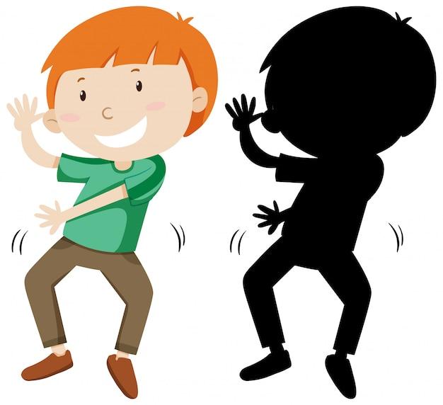 Chłopiec tańczy z jego sylwetka