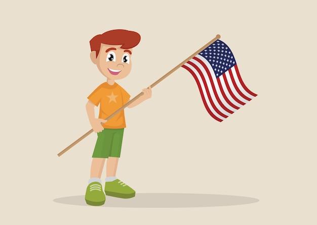 Chłopiec trzyma amerykańską flagę.