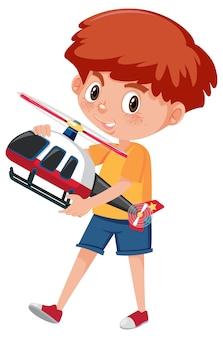 Chłopiec trzyma helikopter zabawka postać z kreskówki na białym tle