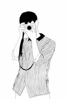 Chłopiec trzyma szkic aparatu