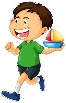 Chłopiec trzyma zabawkę łódź