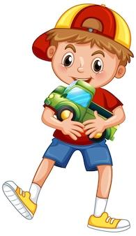 Chłopiec trzyma zabawkę samochodową
