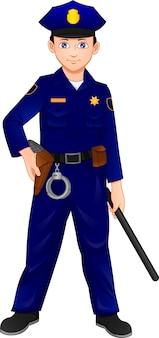 Chłopiec ubrany w strój policji i pozujący z pałkami