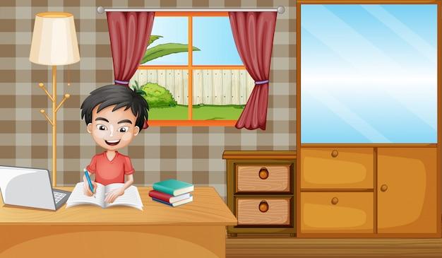 Chłopiec uczy się w domu