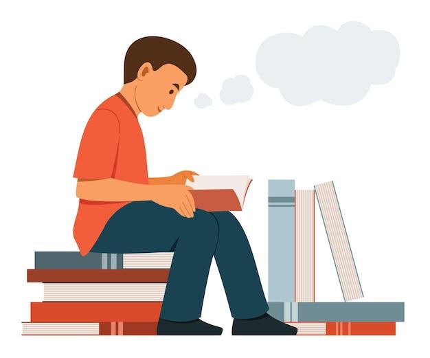 Chłopiec usiądź na stosie dużych książek i poczytaj książkę