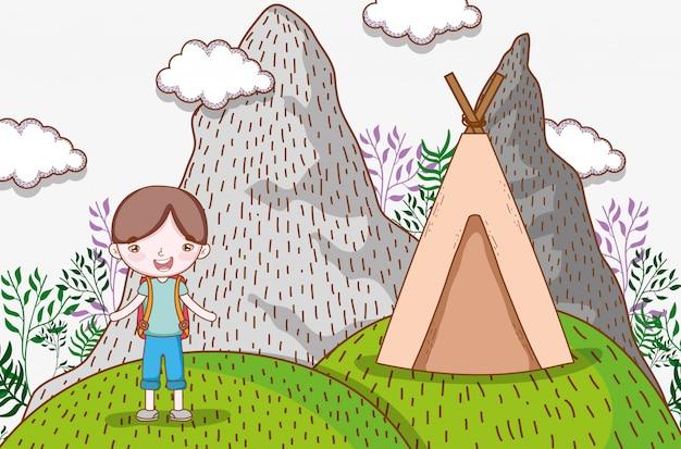 Chłopiec w górach z obozem i rośliny z chmurami
