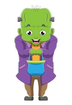 Chłopiec w kostiumie zombie z dużą głową trzyma koszyk z ilustracjami