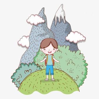 Chłopiec w lodowych górach z chmurami i drzewami