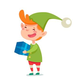 Chłopiec w stroju elfa z ilustracją pudełka na prezent, uśmiechnięta postać z kreskówki gnome na białym tle