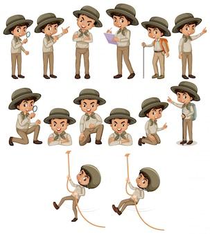Chłopiec w stroju safari robi różne rzeczy