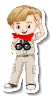 Chłopiec w stroju safari używający naklejki z postacią z kreskówek z lornetką