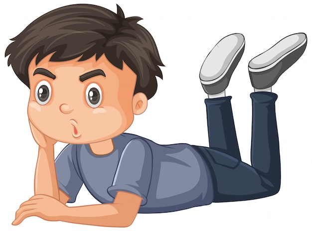 Chłopiec w szarej koszuli na podłodze