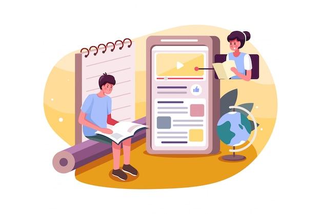 Chłopiec w szkole uczy się kursu online na telefon komórkowy.