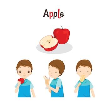 Chłopiec z jabłkiem, sokiem, lodami i literami, owoce tropikalne, zdrowe odżywianie