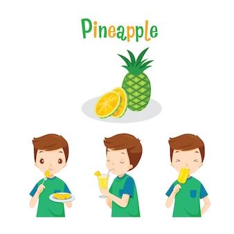 Chłopiec z owocami ananasa, sokiem, lodami i literami, owoce tropikalne, zdrowe odżywianie