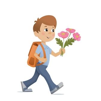 Chłopiec z plecakiem i bukietem kwiatów idzie do szkoły. powrót do szkoły.