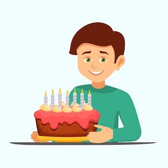 Chłopiec z tortem urodzinowym